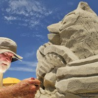 Here's the professional sand sculpting artist at work – Ed Moore of Sandy Feat.  (Photo by Dylan Ray, Carteret County News-Times)
