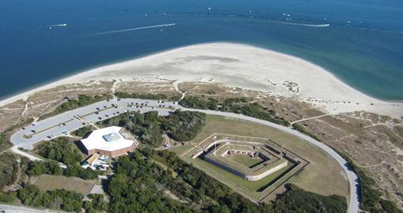 Here's an aerial view of Old Fort Macon (right), a five-sided garrison. To the left is the Fort Macon Coastal Education and Visitors Center, which opened to the public in 2009. At the top is Beaufort Inlet. Photo by Tracey Brinson.