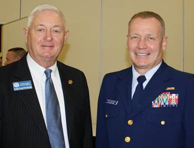 Rear Admiral Stephen Metruck, Commander of the Fifth Coast Guard District (right), presented the Coast Guard Community declaration to Carteret County, and North Carolina Court of Appeals Judge Doug McCullough, a resident of Atlantic Beach, offered congratulatory remarks.