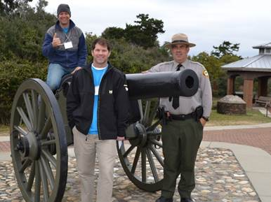 Below: Outside, BG Horvat is mounted on the cannon and shown with class member Craig Parker and Fort Macon State Park Superintendent Randy Newman. (Photos by Lysa Mackey)