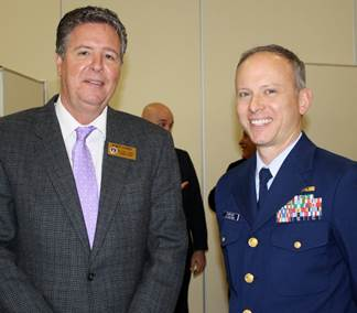 Robin Comer, Chair of the Carteret County Board of Commissioners, and Capt. Joseph Dufresne of Coast Guard Sector North Carolina